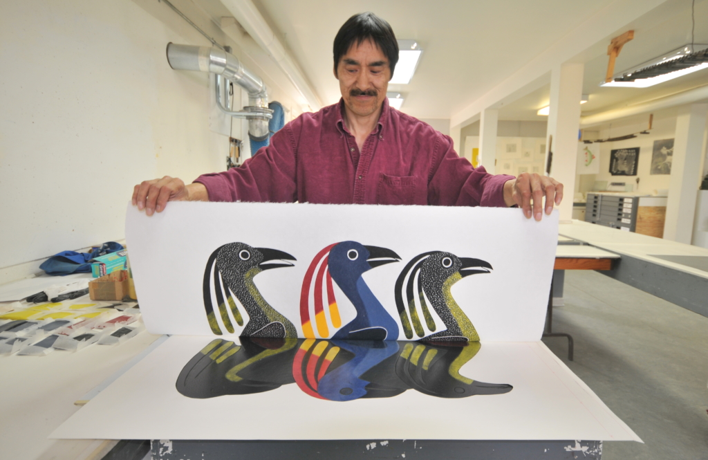 Kavavaow Mannomee preparing a print by Kenojuak Ashevak