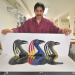 Kavavaow Mannomee preparing a print by Kenojuak Ashevak